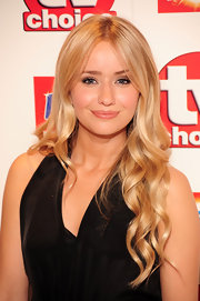 Sammy Winward showed off her center part long curls while hitting the TVChoice Awards.