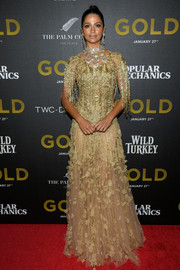 Camila Alves stole the spotlight in a Marchesa gown with a fringed bodice and floral appliques during the world premiere of 'Gold.'