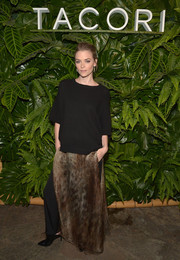 Jaime King styled her sweater with a bronze Sally LaPointe animal-print maxi skirt layered over a pair of pants.