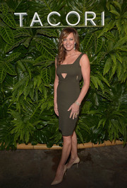 Allison Janney showed off her fab figure in a fitted army-green cutout dress during the Riviera at the Roosevelt event.