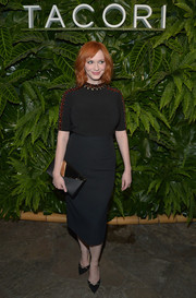 A black envelope clutch with a mirrored flap polished off Christina Hendricks' ensemble.