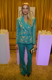 Whitney Port looked cool in her Cynthia Rowley pantsuit, featuring whimsical gold embroidery on a turquoise background, while attending the Tacori in Wonderland event.