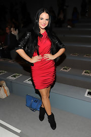 Jojo was red hot in a red ruched jersey dress. She paired the look with booties and a black leather jacket.