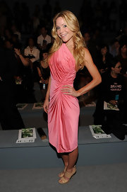 Virginia was pretty and feminine in a cantaloupe one-shoulder ruched jersey dress at Fashion Week.
