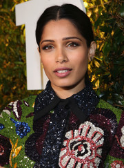 Freida Pinto opted for a casual-chic center-parted ponytail when she attended Take-Two's E3 kickoff party.