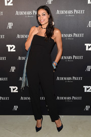 Rosario Dawson opted for a simple yet chic strapless jumpsuit when she attended the Miami Beach kickoff party.
