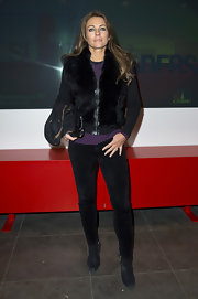 Elizabeth Hurley chose black skinny pants for her glamorous and modern look at the 'CNBC Meets Former President Bill Clinton' screening.
