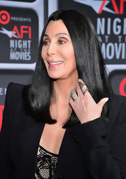 Cher dressed up her subdued outfit with a pair of statement rings when she attended the AFI Night at the Movies.