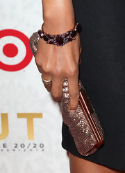 Anika Noni Rose carried this rose-gold chainmail clutch on the red carpet release of Justin Timberlake's album '20/20.'