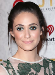Emmy Rossum pulled back her brunette locks into this delicate braided updo.