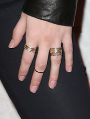 Anna Kendrick sported a wide-band gold ring with etching for her cool red carpet look.