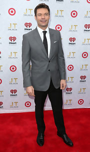 Ryan Seacrest looked super snazzy with this two-button gray and black suit with a cool dotted tie and pocket square.