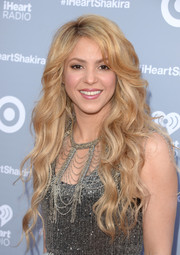 Shakira stuck to her trademark flowing waves during her iHeartRadio album release party.