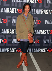 Joy Bryant looked casual in cognac knee high boots. She paired the flat boots with a matching fringed cross body bag and a canvas jacket.