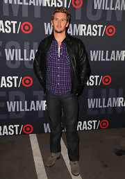 Ryan jumps on the leather trend in this classic jacket style.