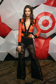 Emily Ratajkowski put her cleavage on display in a deep-V orange and black bodysuit by Balmain during the TargetStyle, in Vogue event.
