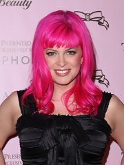 Cosmetic designer Tarina Tarantino attended the launch of her new beauty line. She sported a pink wavy hair-cut with bangs. Wonder if that's a wig she's wearing?