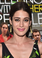 Lizzy Caplan kept her styling low-key with this center-parted chignon at the screening of 'Sleeping with Other People.'