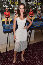 Alison Brie paired her dress with simple silver ankle-strap sandals by Aldo.