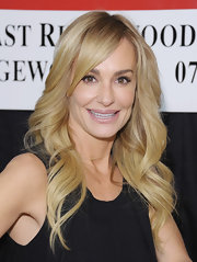 Taylor Armstrong wore her layered cut in big loose waves with long side-swept bangs while promoting her new book.