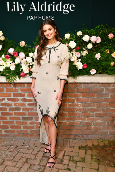 Taylor Hill Fishtail Dress [photo,clothing,white,dress,lady,shoulder,formal wear,fashion,fashion model,pink,footwear,lily aldridge,the bowery terrace,new york city,bowery hotel,taylor hill,lily aldridge parfums launch event,launch event]