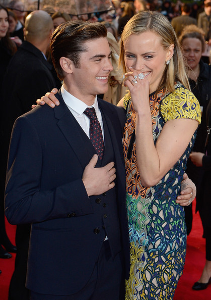 Taylor Schilling Diamond Ring [the lucky one - european film premiere,premiere,event,red carpet,carpet,flooring,yellow,suit,dress,formal wear,photobombing,bluebird,actors,taylor schilling,zac efron,european,england,london]