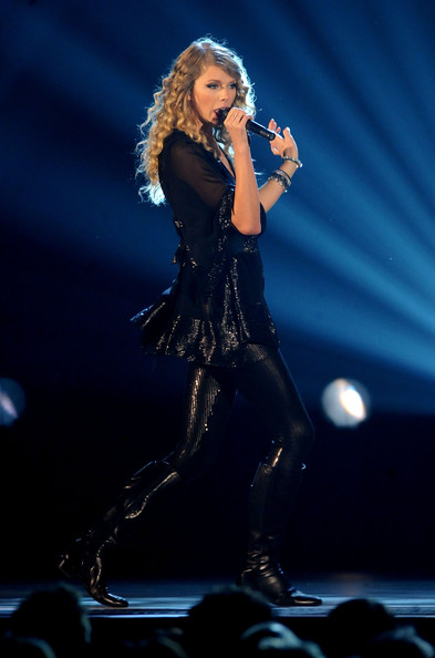 Taylor Swift Knee High Boots [performance,music artist,entertainment,performing arts,singing,music,singer,stage,pop music,event,taylor swift,cma awards,nashville,tennessee,sommet center,show,annual cma awards]