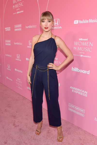 Taylor Swift Jumpsuit [red carpet,taylor swift music,clothing,hairstyle,shoulder,fashion,footwear,carpet,waist,dress,premiere,red carpet,billboard women in music 2019,miss,youtube,celebrity,clothing,hairstyle,taylor swift,youtube music,taylor swift,billboard women in music,miss americana,celebrity,united states,billboard music award for woman of the year,taylor swift music,swifties,billboard music awards]