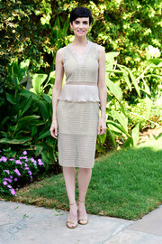 Victoria Summer paired her dress with elegant gold ankle-strap sandals.