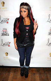 Nicole 'Snookie' Polizzi layered a tight cropped blazer over her glitzy top.