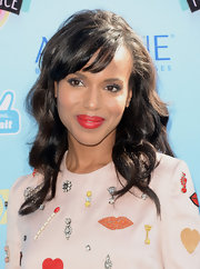 Kerry drew attention to her enviable pout by swiping on a rouge lip.