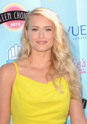Leven tucked her soft blonde waves behind her ear for a voluminous and sexy look.