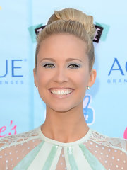 A shiny lip gloss softened Anna Camp's pretty pastel look.