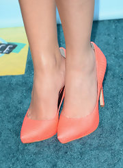 Ashley added a pop of color to her black and blue ensemble by opting for coral snake skin pumps.