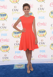 Ciara Bravo contrasted her brightly hued frock with low-key nude ankle-cuff sandals by Steve Madden.