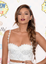 Shay Mitchell chose a dark and sexy shade of red for her lips.