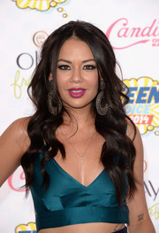 Janel Parrish styled her hair with a center part and sculpted waves for the Teen Choice Awards.