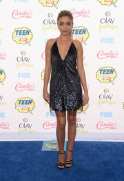 Sarah Hyland kept the allure going with a pair of black Jimmy Choo strappy sandals.