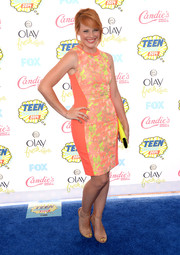Katie Leclerc was all about color and curves in this body-con orange and yellow print dress at the Teen Choice Awards.