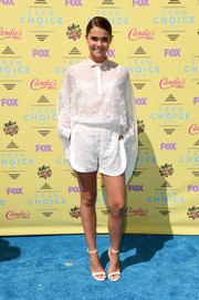 Maia Mitchell completed her adorable look with white eyelet shorts, also by Giamba.