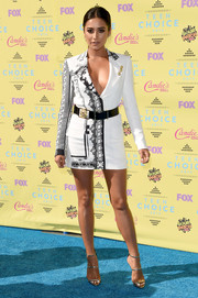 Shay Mitchell chose a Versus Versace printed blazer dress that showcased both cleavage and legs for her Teen Choice Awards look.