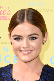 Lucy Hale opted for a sleek center-parted ponytail when she attended the Teen Choice Awards.