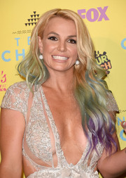 Britney Spears sported a cascade of rainbow-hued waves at the Teen Choice Awards.