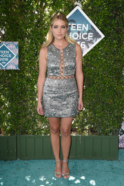 Ashley Benson matched her frock with a pair of silver ankle-strap heels.
