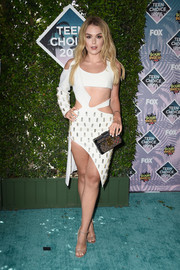 Tallia Storm paired her ultra-sexy dress with gold ankle-strap peep-toe heels.