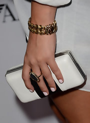 Claire Holt chose a black-and-white clutch to keep in with her white look at the Teen Vogue Young Hollywood Party.