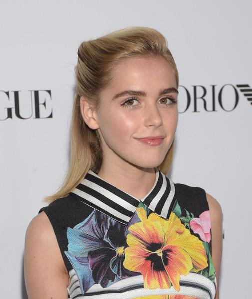 Kiernan Shipka styled her hair into a rolled half-up 'do for the Teen Vogue Young Hollywood Issue party.