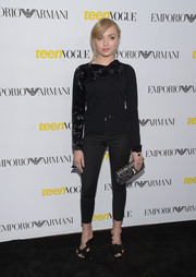Peyton List went for vintage cuteness at the Teen Vogue Young Hollywood Issue party in a black Armani cardigan with a beaded sleeve and bow detail.