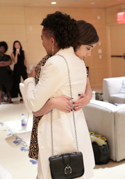 Amandla Stenberg attended the 2018 Teen Vogue Summit carrying an edgy-chic chain-strap bag.