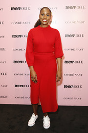 Issa Rae stayed cozy in a red crewneck sweater at the 2019 Teen Vogue Summit.